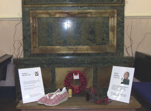 The shoes from Shetland Women's Aid and Carol Smilie in front of the war memorial in South Leith Parish Church