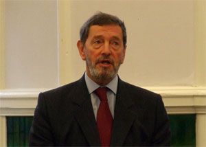 Head and shoulders shot of David Blunkett in suit and red tie