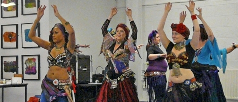 Two rows of women tribal belly dancing