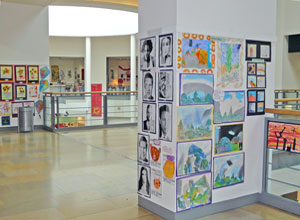 Various posters displayed on pillars in Ocean Terminal
