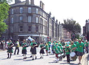 The Sunshine on Leith Pipes and Salsa Band marching up Links Gardens