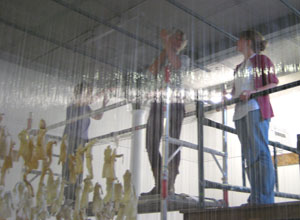 Jane Frere on the scaffolding with Pippa Spencer Nairn, media consultant, seen through the shimmering nylon wires